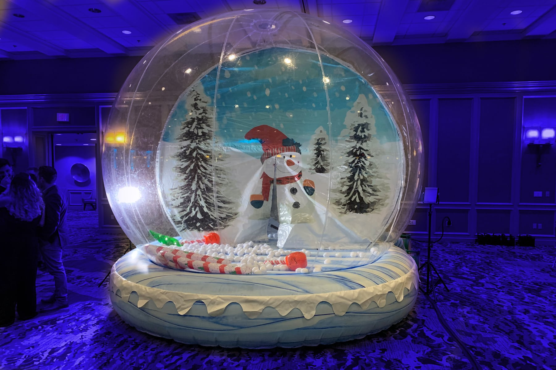 Giant snow globe, inflated and set up to do animated gif photos of guests inside.